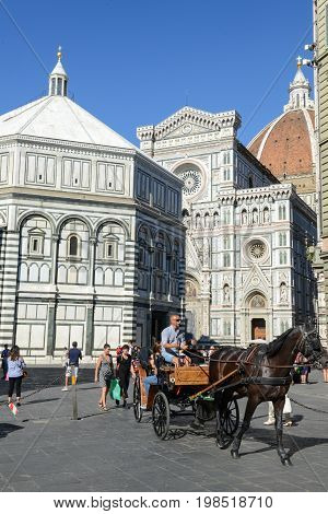 Firenze Italy - 5 July 2017: people walking on Duomo square in front of the cathedral at Florence Italy.