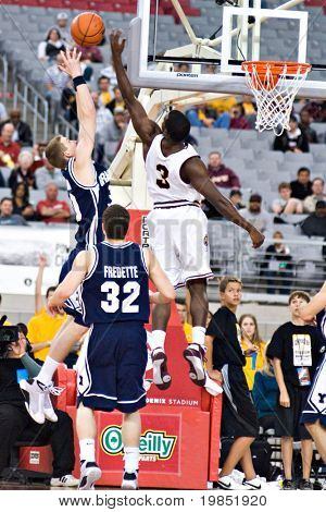 GLENDALE, AZ - DECEMBER 20: Lee Cummard #30 of Brigham Young University and Ty Abbott #3 of Arizona State go up for a rebound in the basketball game on December 20, 2008 in Glendale, Arizona.