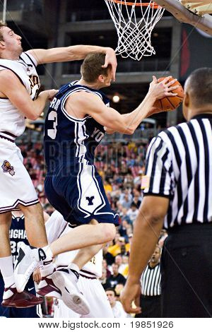 GLENDALE, AZ - DECEMBER 20: Brigham Young center Gavin MacGregor #53 is fouled by Rihards Kuksiks #30 of Arizona State during the basketball game on December 20, 2008 in Glendale, Arizona.