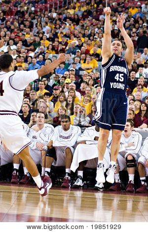 GLENDALE, AZ - DECEMBER 20: Brigham Young forward Jonathan Tavernari #45 puts up a jump shot during the basketball game against Arizona State University on December 20, 2008 in Glendale, Arizona.