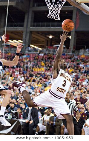 GLENDALE, AZ - DECEMBER 20: Arizona State University guard Ty Abbott #3 stretches to make a lay-up during the basketball game against Brigham Young on December 20, 2008 in Glendale, Arizona.