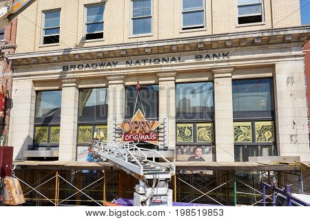NASHVILLE TN USA - APRIL 14 2017: Nashville Opry Originals store sign being dismantled. The store on Broadway street was an iconic presence in a historic building and was permanently closed.