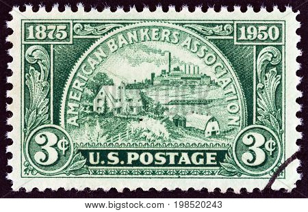 USA - CIRCA 1950: A stamp printed in USA issued for the 75th anniversary of American Bankers Association shows Coin, symbolizing fields of Banking Service, circa 1950.