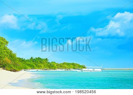 View of boat and sea beach at tropical resort