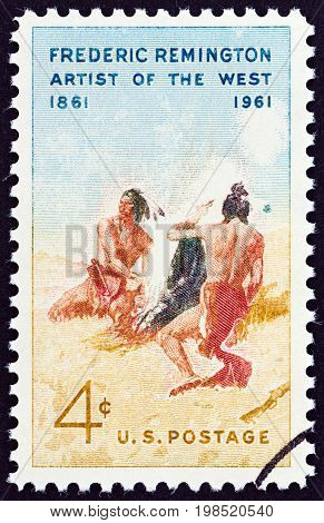 USA - CIRCA 1961: A stamp printed in USA issued for the birth centenary of Frederic Remington shows The Smoke Signal after Remington, circa 1961.