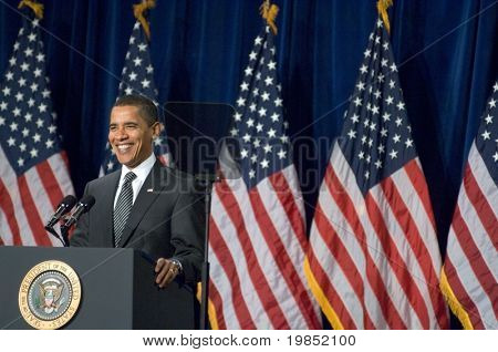MESA, AZ - FEBRUARY 18: President Barack Obama smiles at the crowd before speaking about the home mortgage crisis at Dobson High School on  February 18, 2009 in Mesa, AZ.