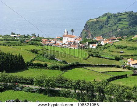 Lajes das Flores village seen behind a patchwork of fields, Flores island, The Azores