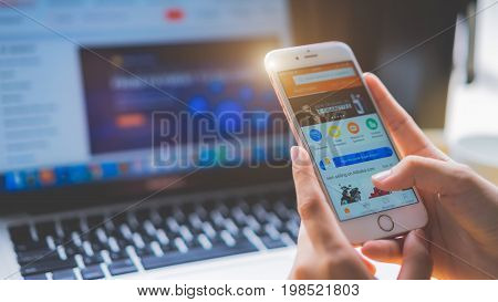 Singapore - July 20, 2017 : Woman Use Iphone 6S. To Shop Online Alibaba Aliexpress App On The Screen