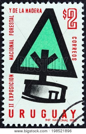 URUGUAY - CIRCA 1970: A stamp printed in Uruguay issued for the 2nd anniversary of the National Forestry Exhibition shows Stylized Tree, circa 1970.