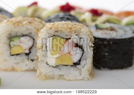 Crispy sushi roll with snow crab closeup as a part of sushi set. Macro. Photo can be used asa whole background.