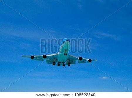 A 747 jumbojet landing in an airport