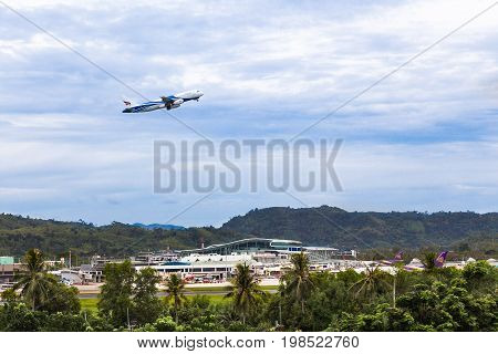Phuket Thailand - 8 July 2017 - Bangkok Airways' aircraft takes off from Phuket International Airport Phuket Thailand on July 8 2017 on a cloudy rainy day