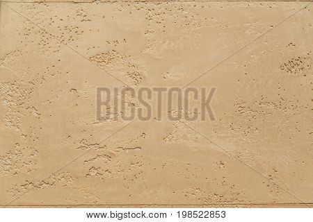 Wall yellow texture sandstone background. Plaster wall