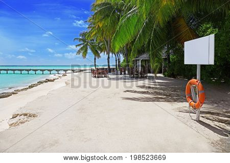 Sea beach at tropical resort in summer day