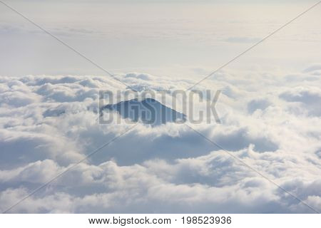 Mountain peak above sea of clouds at Mountain Fuji (Fujisan) climbing trail Japan