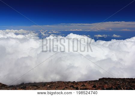 Clouds above mountain high and blue sky at Mountain Fuji (Fujisan) climbing trail Japan