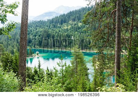 Caumasee in Switzerland lake with turquoise water for hiking and swimming