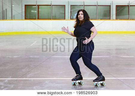 woman dancing on quad roller skates in an arena