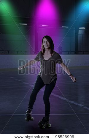 woman dancing on roller skates in an arena