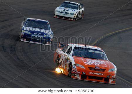 AVONDALE, AZ - APRIL 18: Joey Logano #20 leads a group of cars at the NASCAR Sprint Cup race at the Phoenix International Raceway on April 18, 2009 in Avondale, AZ.