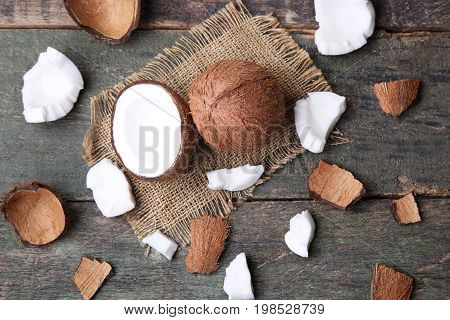 Coconuts with sackcloth on the wooden table