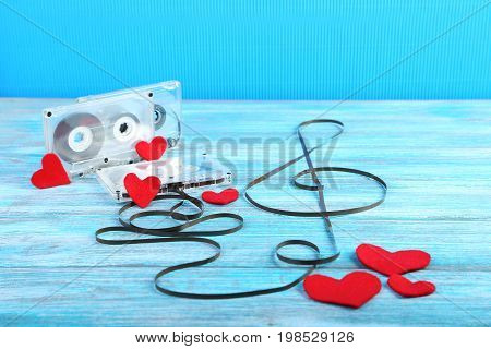 Cassette tapes on the blue wooden table