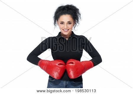 Gorgeous brunette young woman smiling confidently wearing boxing gloves isolated on white femininity confidence power strength sport concept.