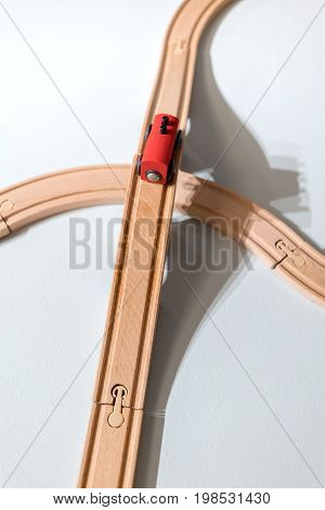 Red Train Toy On Plastic Wooden Track Isolated On White