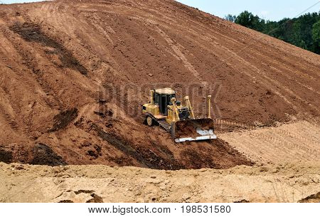 Bulldozer working at construction site Georgia, USA.