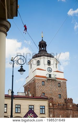 LUBLIN POLAND- 29 july 2017- slackliner in old town at Urban Highline Festival placed in city space of Lublin - biggest slacklining spectacle in the world