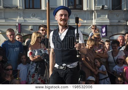 LUBLIN, POLAND- 29 july 2017- street performer fire swallowerl at Carnaval Sztukmistrzow Festival placed in city space of Lublin dedicated to theatre, circus and street art