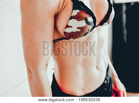 Close up of fit woman's torso. Female with perfect abdomen muscles.