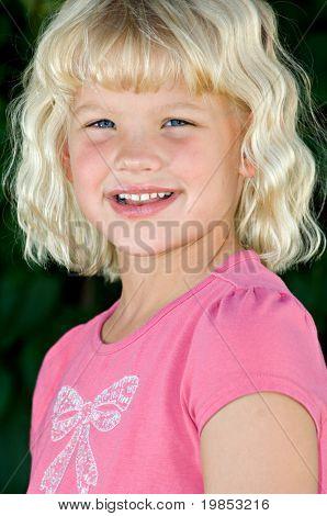 A beautiful, cherubic six year old blond girl