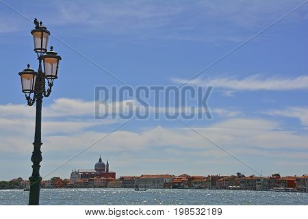The island of Giudecca in the Dorsoduro quarter of Venice viewed from the opposite side of the Giudecca canal. Il Redentore (Basilica del Redentore or Chiese del Santissimo Redentore) designed by Palladio in 1577 stands out on the skyline.