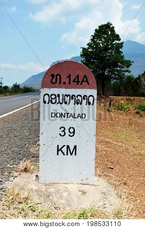 Old Milestone on the road information distance Dontalad with Pakse on May 1 2015 in Champasak Laos