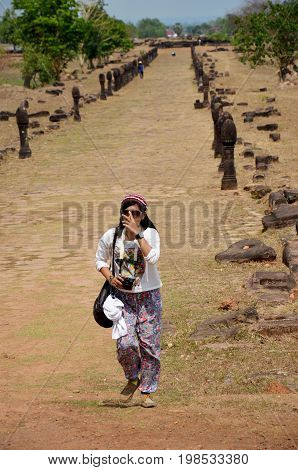 Traveler Thai Woman Travel Visit And Shooting Photo At Archaeological Site Wat Phu Or Vat Phou