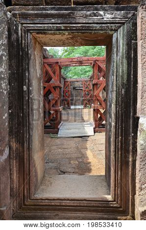 Gate and pathway inside Wat Phu or Vat Phou castle is a ruined Khmer Hindu temple in Pakse Champasak Laos