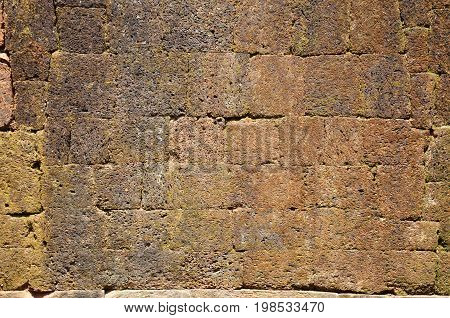 Ancient floor laterite stone background at archaeological site Wat Phu or Vat Phou 10th century is a ruined Khmer Hindu temple in Champasak Laos