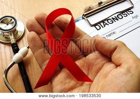 A Symbol of HIV/AIDS. Red awareness ribbon.