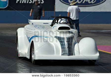 CHANDLER, AZ - OCTOBER 1: A hot rod car competes in the NHRA Pacific Division drag racing championship on October 1, 2009 in Chandler, Arizona.