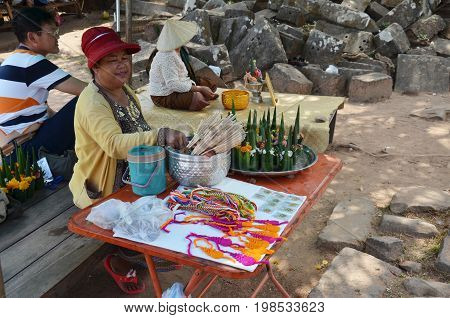 Laos Woman Sale Sacrificial Offering Made From Banana Leaf And Flower For People Praying To Buddha A