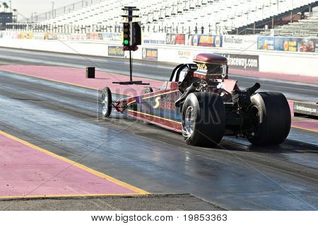 CHANDLER, AZ - OCTOBER 1: A dragster competes in the NHRA Pacific Division drag racing championship on October 1, 2009 in Chandler, Arizona.