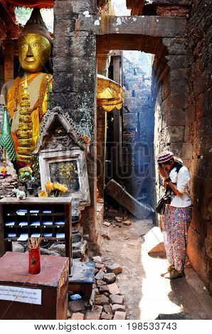 Thai Woman Praying Ruins Buddha Statue Image At Vat Phou Or Wat Phu
