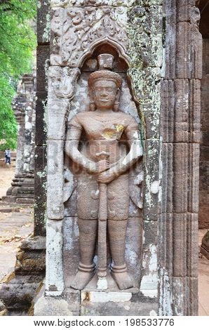 Vaisravana Or Vessavaṇa Giant Guardian Statue In Archaeological Site At Vat Phou Or Wat Phu