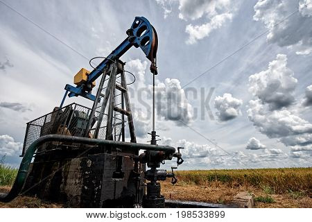 Oil pump in front of the cloudy sky oil industry equipment