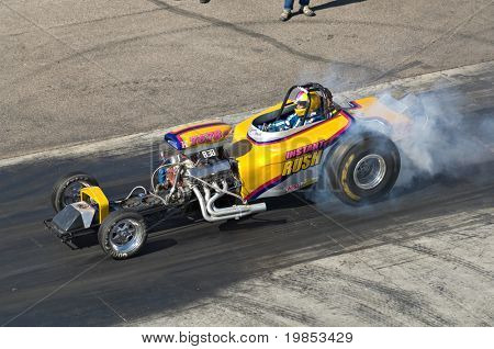 CHANDLER, AZ - OCTOBER 2: A dragster burns out before the start of the race in the NHRA Pacific Division drag racing championship on October 2, 2009 in Chandler, Arizona.
