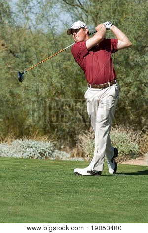 SCOTTSDALE, AZ - OCTOBER 21: Justin Leonard hits a drive in the Frys.com Open PGA golf tournament on October 21, 2009 in Scottsdale, Arizona.