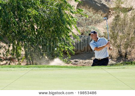 SCOTTSDALE, AZ - OCTOBER 21: Tom Lehman hits out of a sand trap in the Frys.com Open PGA golf tournament on October 21, 2009 in Scottsdale, Arizona.