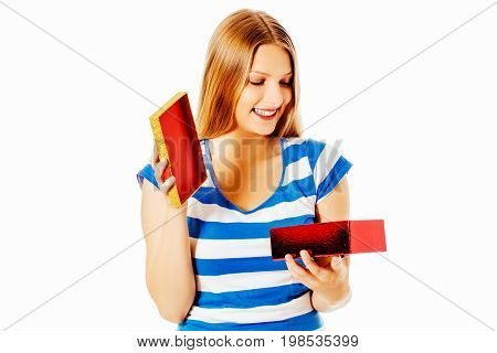 Close-up of female unpacking a present, isolated on white