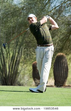 SCOTTSDALE, AZ - OCTOBER 22: Justin Leonard hits a drive in the Frys.com Open PGA golf tournament on October 22, 2009 in Scottsdale, Arizona.
